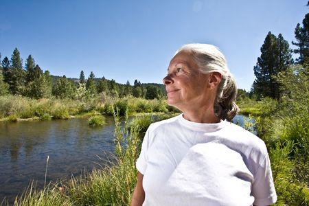 woman on river bank
