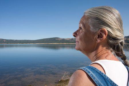 woman looking at lake Stock Photo