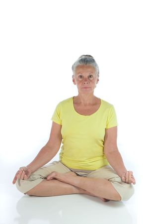 senior woman in yoga pose on white Stock Photo - 3692991