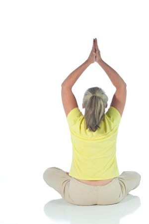 senior woman in yoga pose on white Stock Photo - 3692984