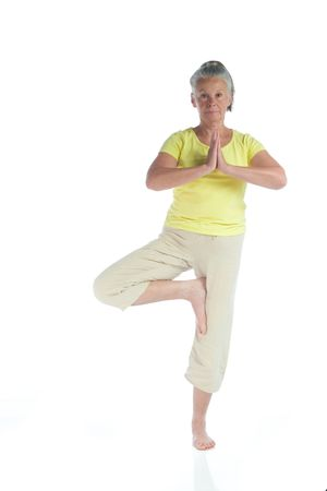 senior woman in yoga pose on white Stock Photo - 3692982