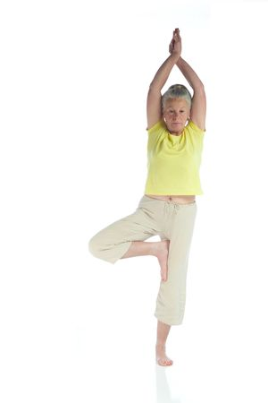 senior woman in yoga pose on white Stock Photo - 3692980