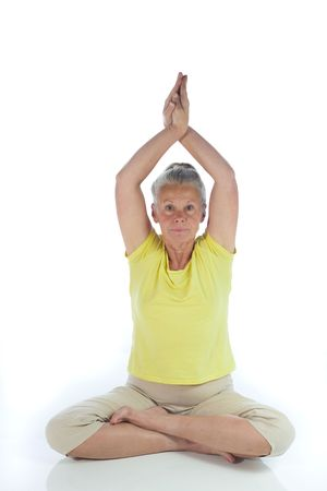 senior woman in yoga pose on white Stock Photo - 3692988