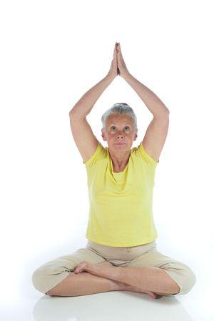 senior woman in yoga pose on white Stock Photo - 3692986