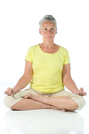 senior woman in yoga pose on white