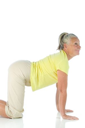 senior woman in yoga pose on white Stock Photo - 3692989