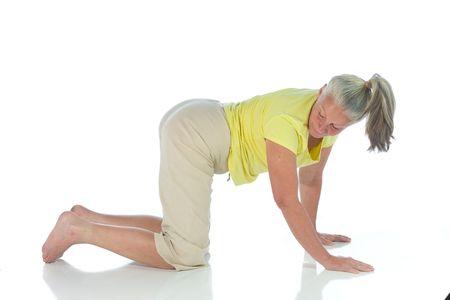 senior woman in yoga pose on white Stock Photo - 3692990