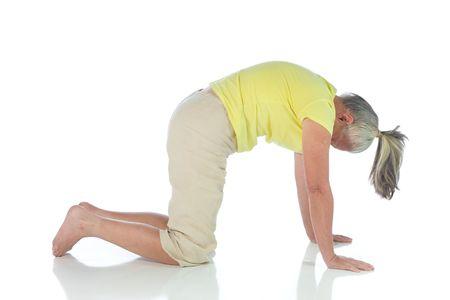 senior woman in yoga pose on white Stock Photo - 3692985