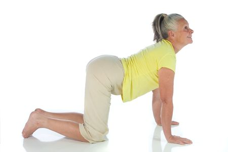 senior woman in yoga pose on white Stock Photo - 3692987