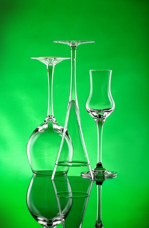 Three wineglasses with a green light