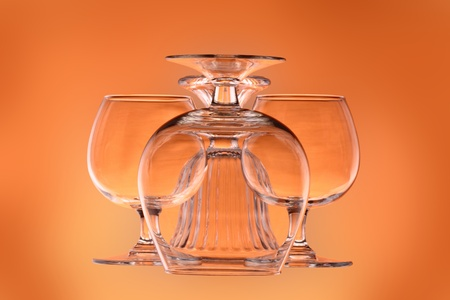 Three wineglasses and a glass vase Stock Photo