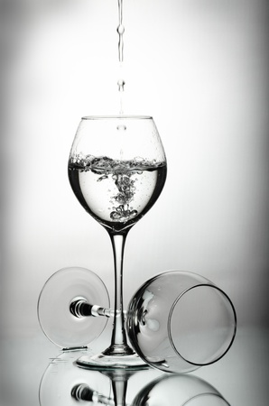 Two wineglasses and water drops photo