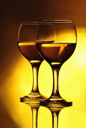 Two wineglasses with a white wine photo