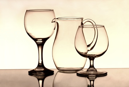 Two wineglasses and a jug on the mirror photo