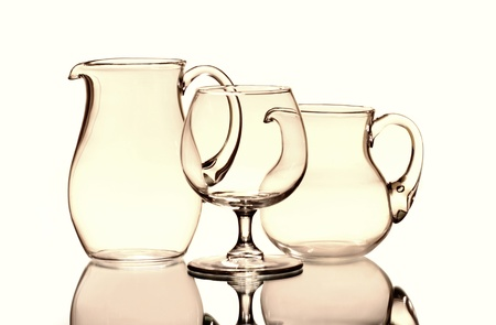 One wineglass and two empty jugs