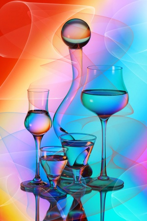 Four wineglasses, a vase and a glass bowl photo