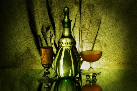A vase, two wineglasses and four glass balls photo