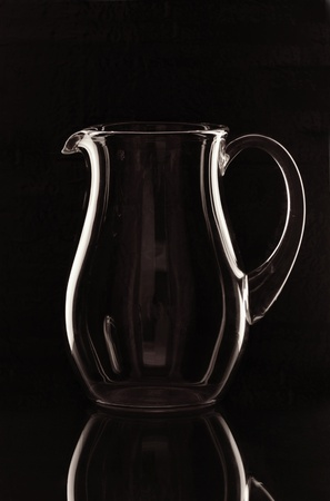 A glass jug on the mirror Stock Photo