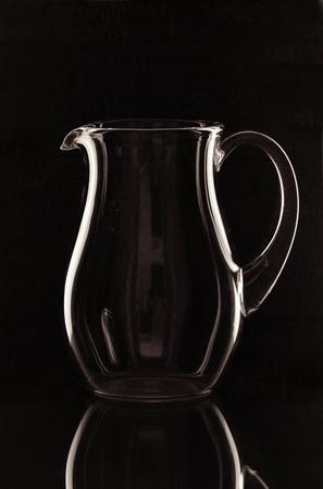 A glass jug on the mirror Stock fotó