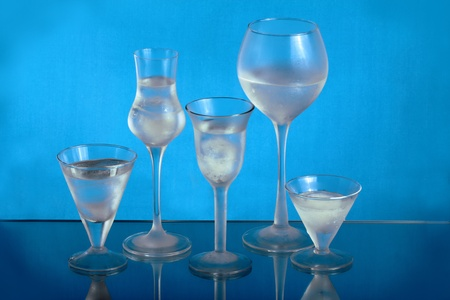 Five wineglasses with ice and water Stock Photo