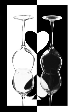 Creative composition with two wineglasses and a heart photo
