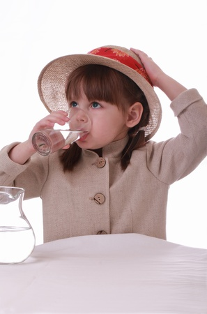 a little girl drinks water from a glass Stock Photo - 12537574