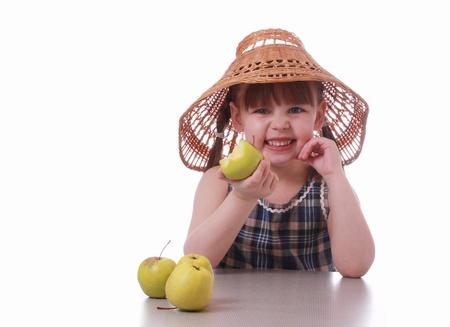 A little girl eating an apple Stock Photo - 12537577