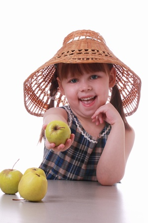 a little girl offers an apple Stock Photo - 12537609