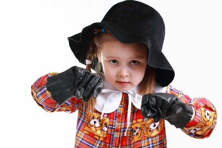 short gloves: A little girl in the hat and gloves boxing