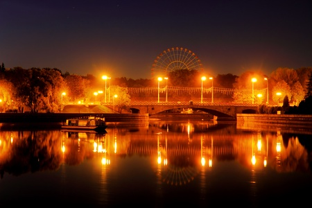 Night city lights are reflected in the  waters of the river Stock fotó