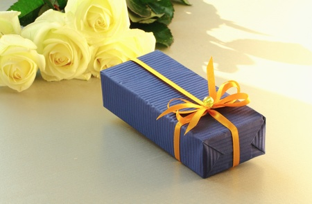 A gift box and a bouquet of beautiful white roses