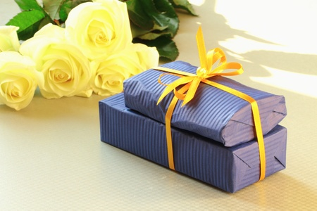 A gift box and beautiful white flowers