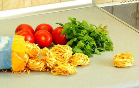 Noodles, tomatoes and a parsley Stock Photo