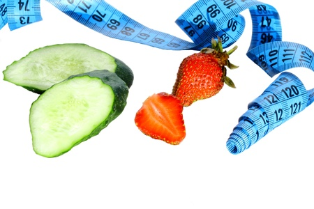 subtly: Two pieces of cucumber, strawberries and a metre measure ruler Stock Photo