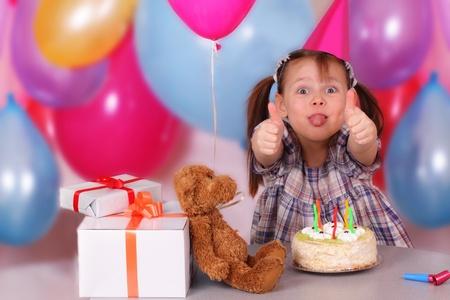 Birthday celebration of funny little girl