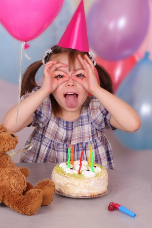 Birthday of funny little girl photo