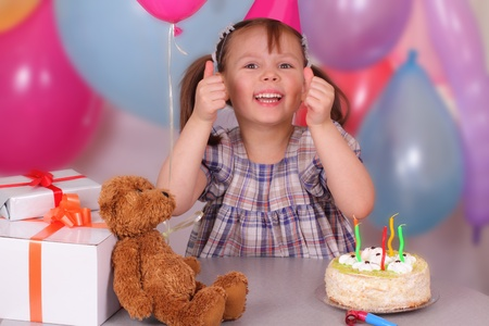Funny little girl celebrates her Birthday photo