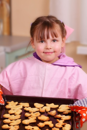 Little girl bakes biscuits Stock Photo