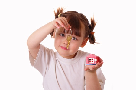 Little girl holds a key in her hand Stock Photo