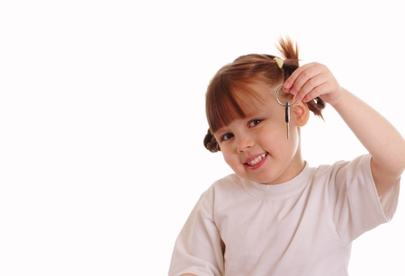 Little girl holds a key photo