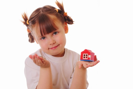 Little girl with a key and a house in her hands