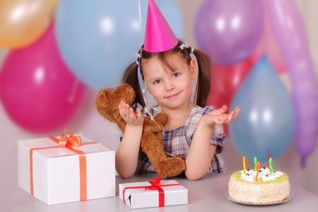 Funny little girl on her Birthday Stock Photo - 12952735