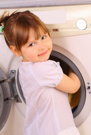 A little girl puts the towels