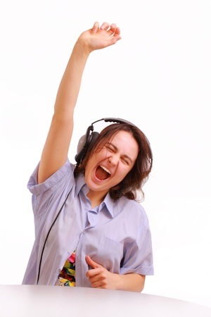 A young girl in headphones enjoying the music Stock Photo - 12953214