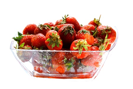 subtly: Juicy strawberries in the glass bowl