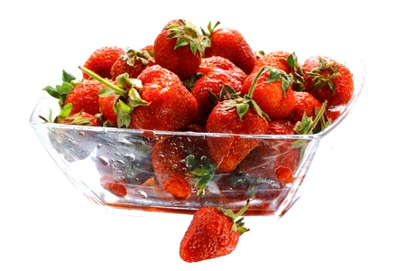 subtly: Many appetizing strawberries in the glass bowl