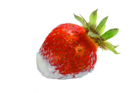 subtly: Ripe appetizing strawberry in a white cream