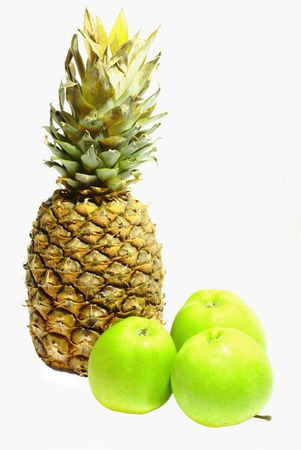subtly: Ripe pineapple and three green apples