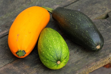 Tasty marrow squashes on the wooden boards