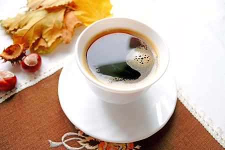 Cup of coffee in the Autumn day photo